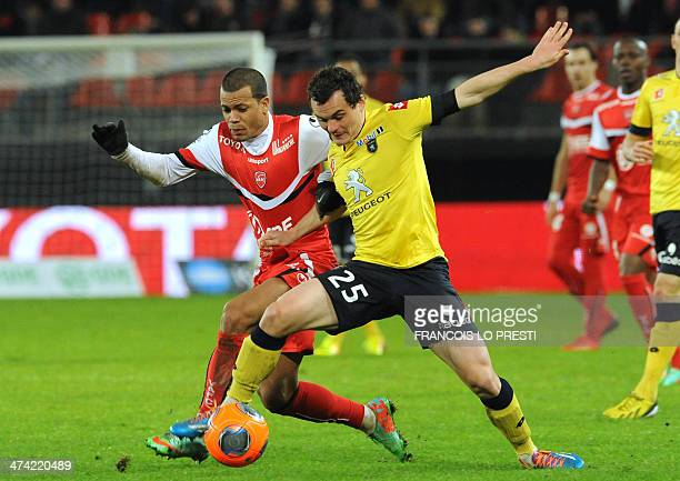 Valenciennes French midefielder Matthieu Dossevi vies for the ball with Sochaux' French defender Julien Faussurier during the French L1 football...