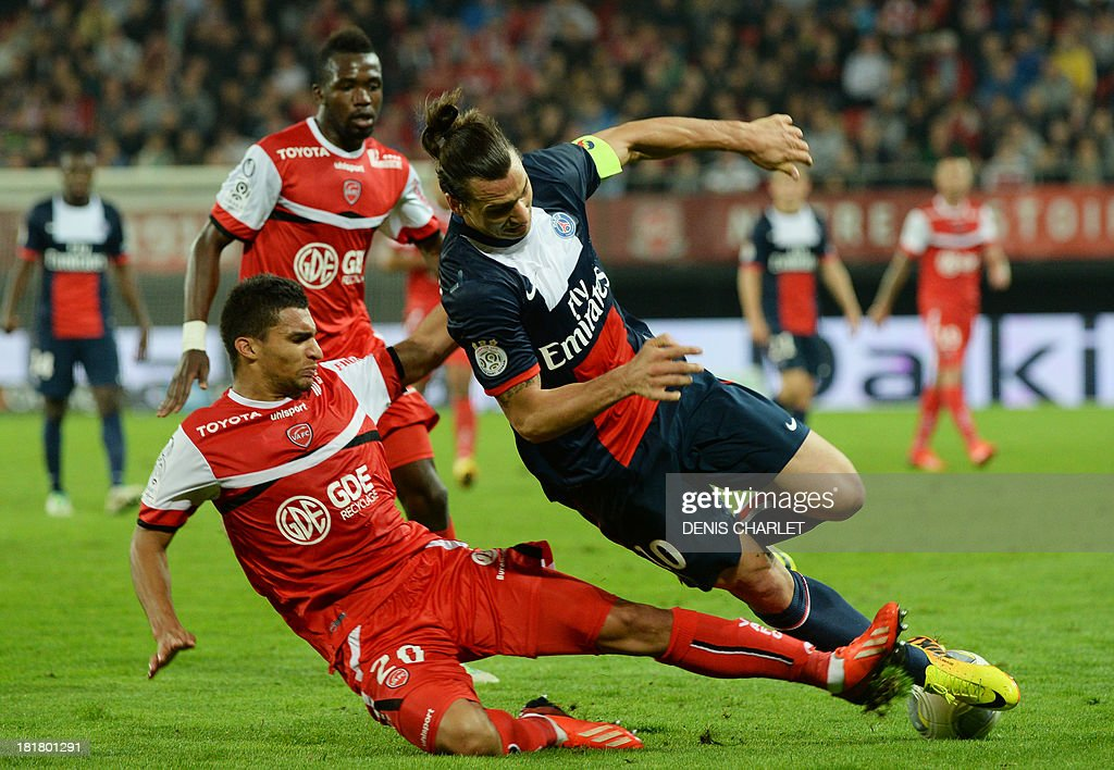 Valenciennes' French midfielder Lindsay Rose (L) tackles Paris Saint-Germain's Swedish forward <a gi-track='captionPersonalityLinkClicked' href=/galleries/search?phrase=Zlatan+Ibrahimovic&family=editorial&specificpeople=206139 ng-click='$event.stopPropagation()'>Zlatan Ibrahimovic</a> during a French L1 football match between Valenciennes and Paris Saint-Germain on September 25, 2013 at the Stade du Hainaut in Valenciennes, northern France.