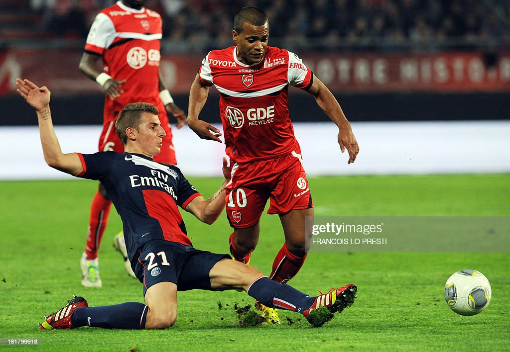 Valenciennes' French midfielder Matthieu Dossevi (R) is tackled by Paris Saint-Germain's French defender Lucas Digne during a French L1 football match between Valenciennes and Paris Saint-Germain on September 25, 2013 at the Stade du Hainaut in Valenciennes, northern France.