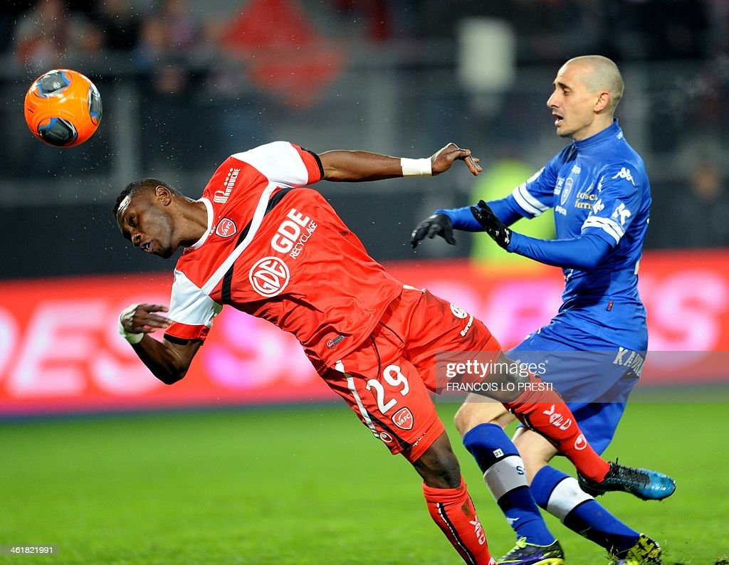 Valenciennes' Majeed Waris heads the ball next to Bastia's Algerian defender Fethi Harek during the French L1 football match Valenciennes vs Bastia...