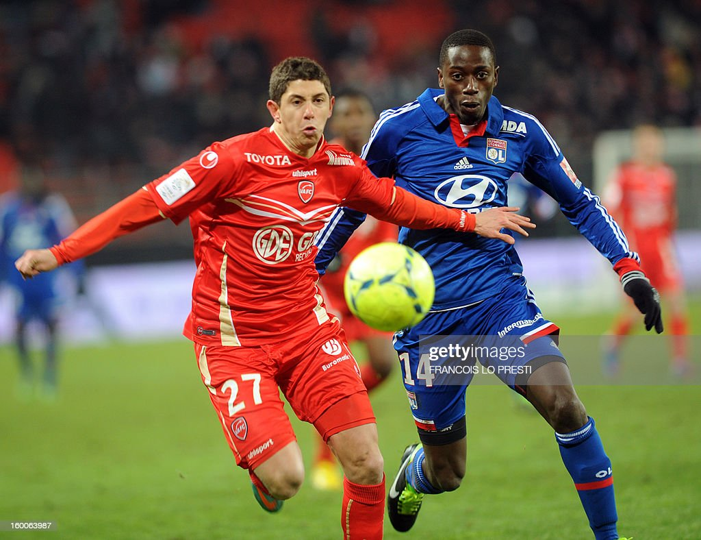 Valenciennes' Maor Melikson (L) vies with Lyon's Senegalese defender Mouhamadou Dabo during the French L1 football match Valenciennes vs Olympique lyonnais at the stadium 'stade du hainaut' in Valenciennes on January 25, 2013.