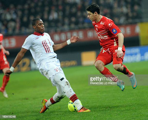 Valenciennes' Melikson vies with Lille's French defender Dijbril Sidibe during the French L1 football match Valenciennes vs Lille at the Hainaut...
