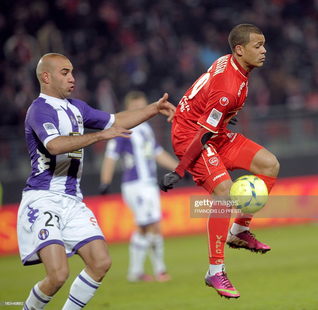 Valenciennes midefielder Mathieu Dossevi (R) vies with Toulouse's Tunisian defender Aymen Abdennour during their French L1 football match at the 'stade du hainaut' in Valenciennes on February 23 2013. AFP PHOTO FRANCOIS LO PRESTI