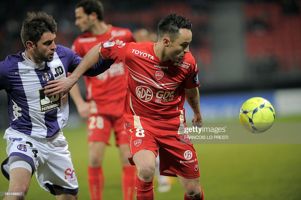 Valenciennes midfielder Gael Danic vies with Toulouse's Serbian defender Pavle Ninkov during their French L1 football match at the 'stade du hainaut' in Valenciennes on February 23 2013.
