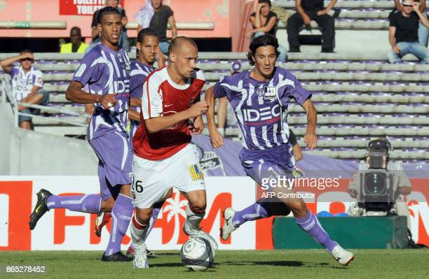Valenciennes mildfielder Renaud Cohade vies with Toulouse Pantxi Sirieix during their French L1 football match Toulouse vs Valenciennes on August 30...