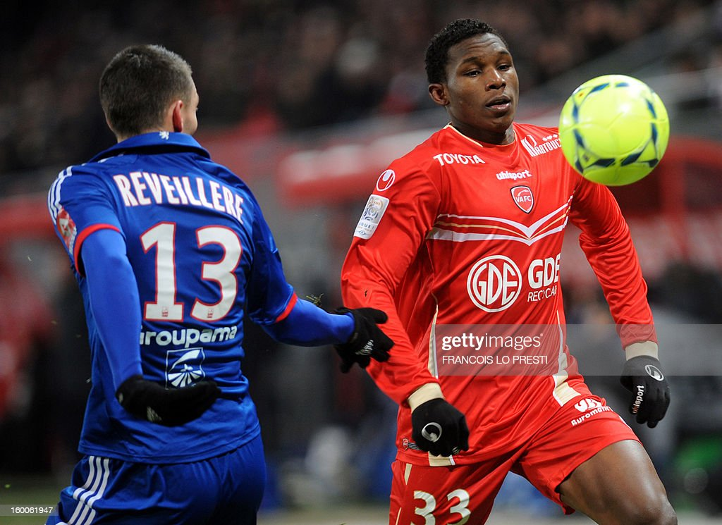 Valenciennes' Opa Nguette (R) vies with Lyon's French forward Anthony Reveillere during the French L1 football match Valenciennes vs Olympique lyonnais at the stadium 'stade du hainaut' in Valenciennes on January 25, 2013.