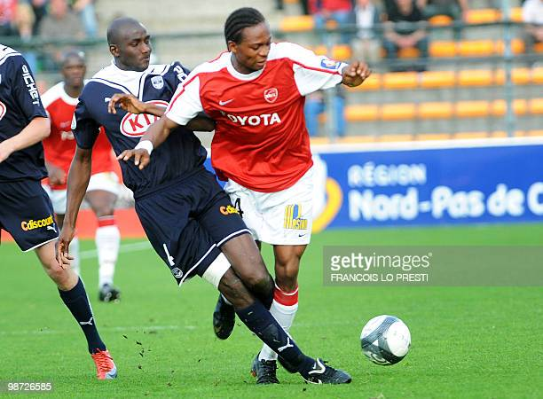 Valenciennes' player Gaetan Bong vies with Bordeaux' player Abdou Traore during their L1 football match Valenciennes vs Bordeaux on April 28 2010 at...