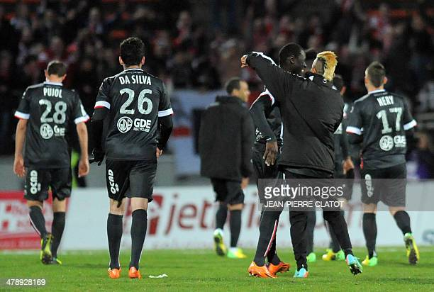 Valenciennes' players Gregory Pujol Marco Da Silva and Loris Nery leave the pitch following the French L1 football match EvianThonon vs Valenciennes...