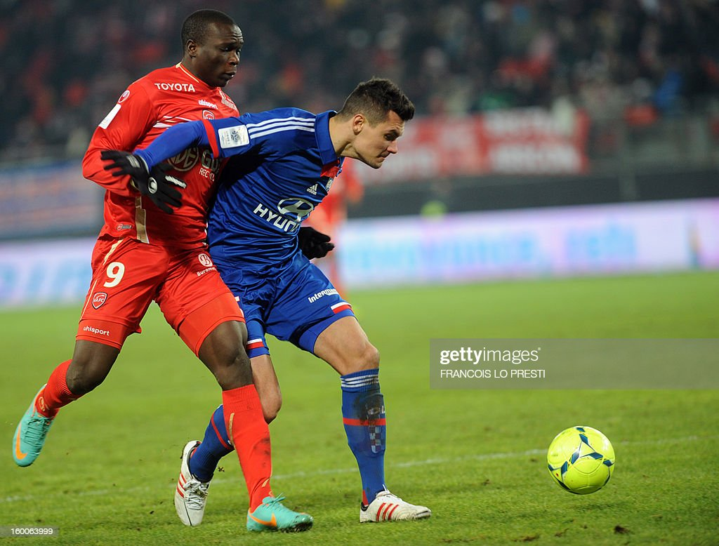Valenciennes' Vincent Aboubakar(L) vies with Lyon's Croatian defender Dejan Lovren during the French L1 football match Valenciennes vs Olympique lyonnais at the stadium 'stade du hainaut' in Valenciennes on January 25, 2013.