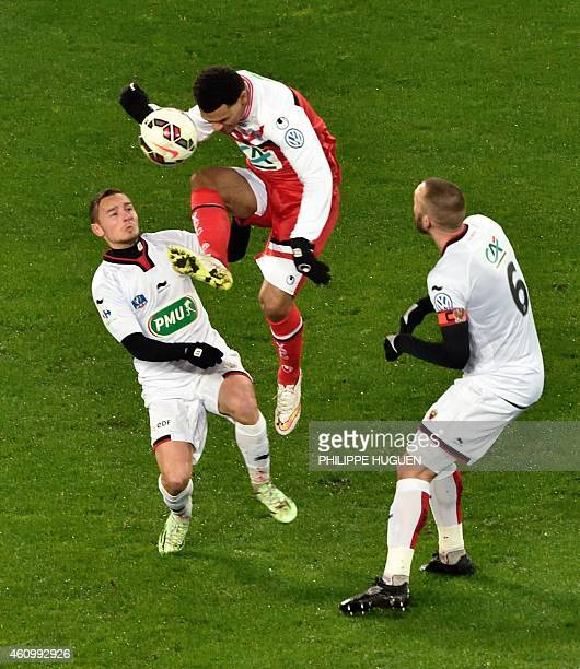 Valenciennes'forward Opa N'gette vies with Nice's defender Mathieu Bodmer during the French Cup football match Valeniennes vs Nice on January 3 2015...