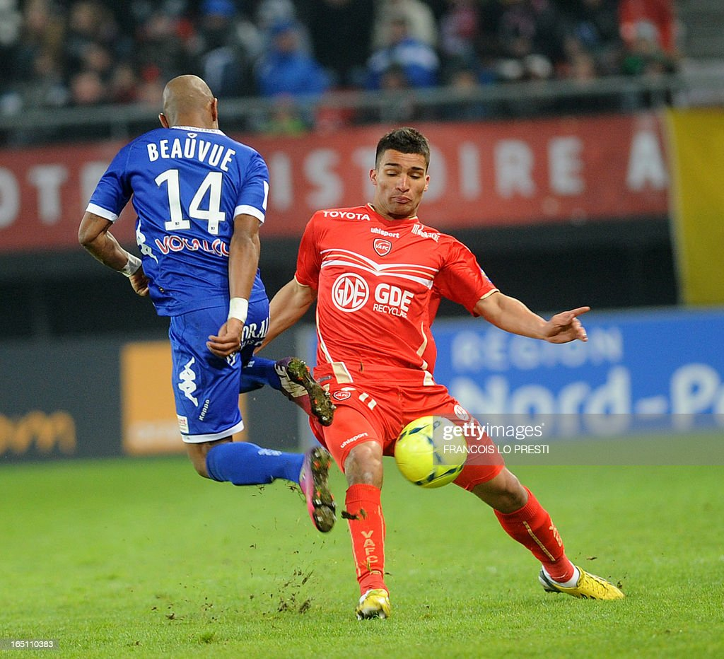 Valenciennes's French defender Lindsay Rose (R) vies for the ball with Bastia's French forward Claudio Beauvue during the French L1 football match Valenciennes vs Bastia on March 30, 2013 at the Hainaut Stadium in Valenciennes.