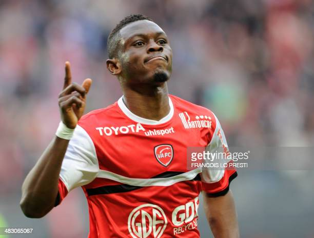 Valenciennes's Majeed Waris celebrates after scoring a goal during the French L1 football match Valenciennes vs Lyon on April 6 2014 at the Hainaut...