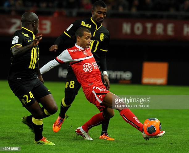 Valenciennes's Mathieu Dossevi vies with Lille's Ivoirian forward Salomon Kalou and Lille's French midfielder Rio Mavuba during a French L1 football...