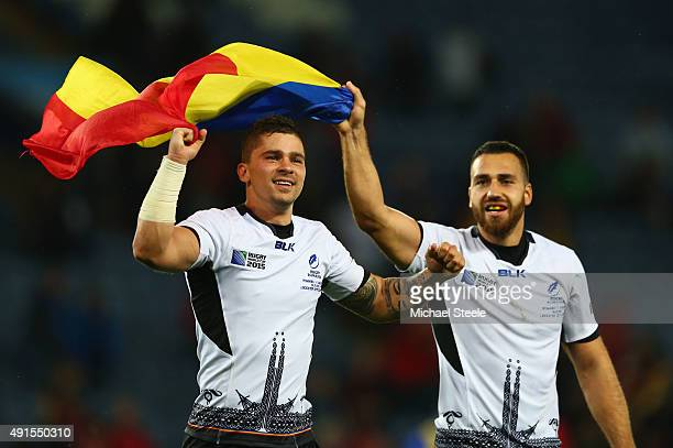 Valentin Calafeteanu and Madalin Lemnaru of Romania celebrate victory with team mates after the 2015 Rugby World Cup Pool D match between Canada and...