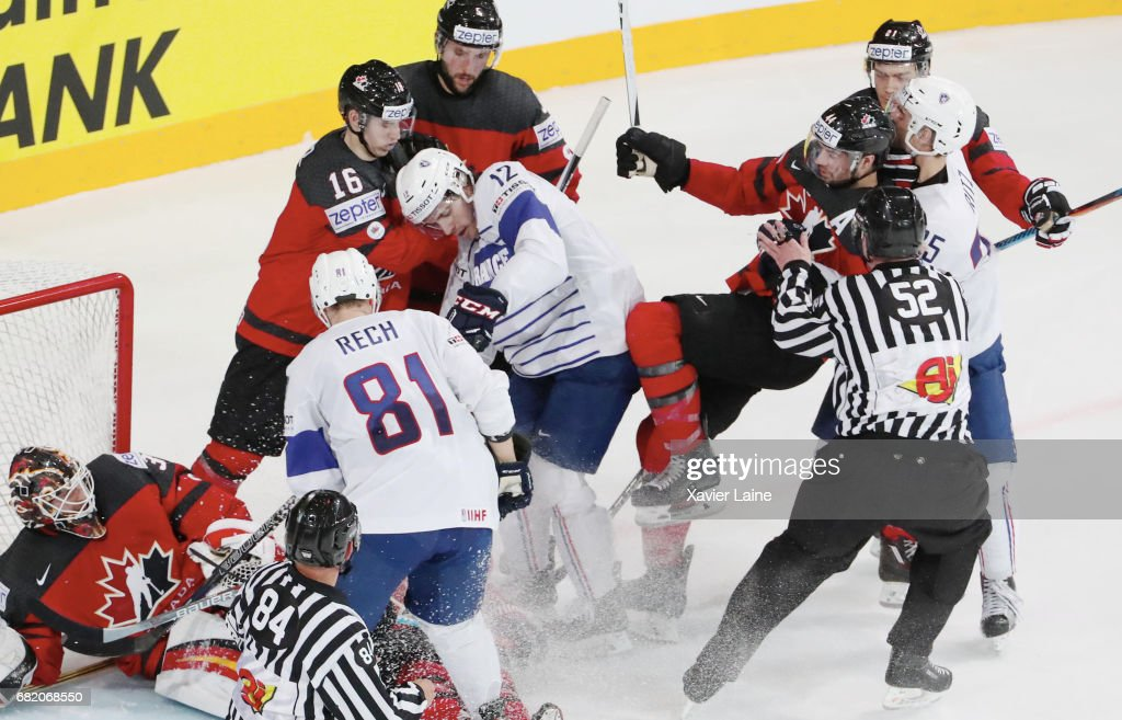 Valentin Claireaux #12 of France is slash by Marc-Edouard Vlasic of Canada during the 2017 IIHF Ice Hockey World Championship game between Canada and France at AccorHotels Arena on May 11, 2017 in Paris, France.