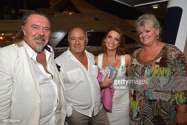 Valentin de Vecsey from Olaxkaya Vodka producer Alain Williams singer Regina Rebecca and Mrs de Vecsey attend the 'Yachts' Cocktail Party at the...