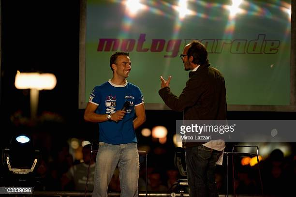 Valentin Debise of French and WTR San Marino Team speaks with the italian journalist Guido Meda during the preevent MotoGP Riders Parade ahead of San...