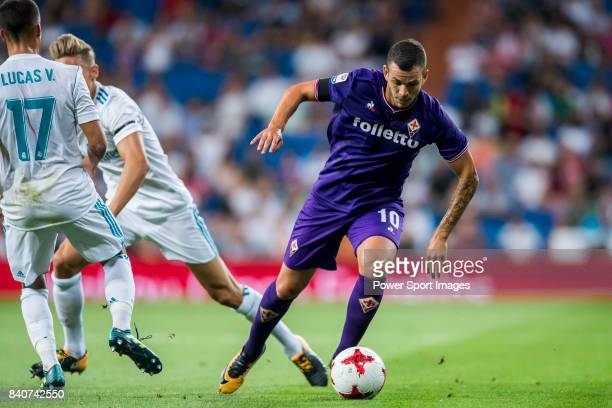 Valentin Eysseric of ACF Fiorentina battles for the ball with Marcos Llorente of Real Madrid during the Santiago Bernabeu Trophy 2017 match between...