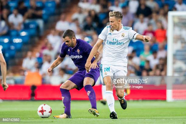 Valentin Eysseric of ACF Fiorentina fights for the ball with Marcos Llorente of Real Madrid during the Santiago Bernabeu Trophy 2017 match between...