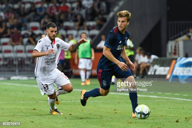 Valentin Eysseric of Nice and Joel Veltman of Ajax Amsterdam during the UEFA Champions League Qualifying match between Nice and Ajax Amsterdam at...