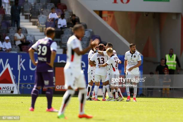 Valentin Eysseric of Nice celebrates with his teammates after scoring a goal during the Ligue 1 match between Toulouse FC and OGC Nice at Stadium...