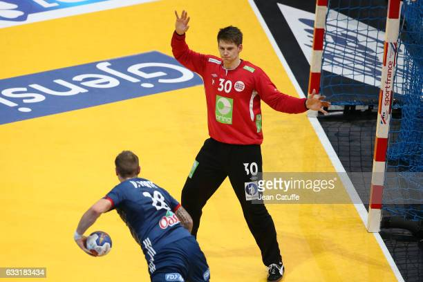Valentin Laporte of France scores a goal against goalkeeper of Norway Torbjorn Bergerud during the 25th IHF Men's World Championship 2017 Final...