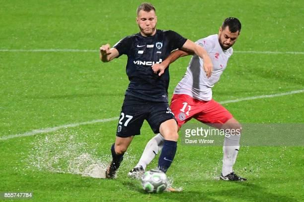 Valentin Lavigne of Paris FC and Teji Savanier of Nimes during the Ligue 2 match between Paris FC and Nimes on September 29 2017 in Paris France