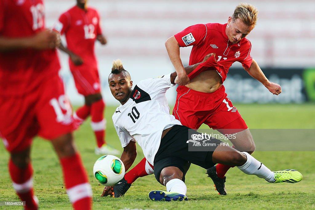 Valentin Lazaro (L) of Austria is challenged by Jordan Haynes of Canada during the FIFA U-17 World Cup UAE 2013 Group E match between Canada and Austria at Al Rashid Stadium on October 19, 2013 in Dubai, United Arab Emirates.