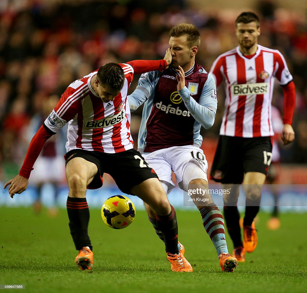 Valentin Roberge of Sunderland holds off <a gi-track='captionPersonalityLinkClicked' href=/galleries/search?phrase=Andreas+Weimann&family=editorial&specificpeople=5891558 ng-click='$event.stopPropagation()'>Andreas Weimann</a> of Aston Villa during the Barclays Premier League match between Sunderland and Aston Villa at Stadium of Light on January 1, 2014 in Sunderland, England.