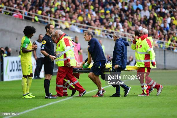 Valentin Rongier of Nantes is carried off injured during the Ligue 1 match between FC Nantes and Olympique Marseille at Stade de la Beaujoire on...