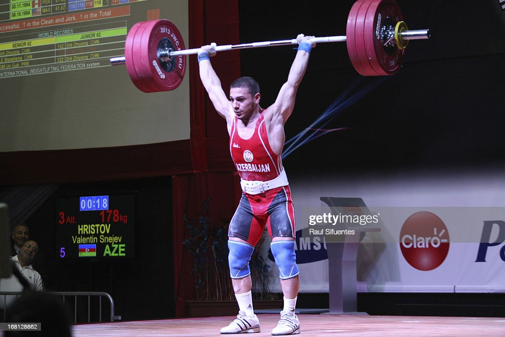 Valentin Snezhev Hristov of Azerbaijan A sets a new junior world record in the Mens 62 kg Clean and Jerk during day two of the 2013 Junior Weightlifting World Championship at Maria Angola Convention Center on April 05, 2013 in Lima, Peru.