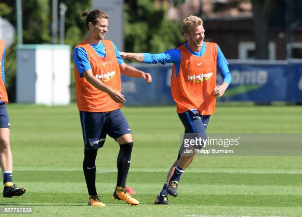 Valentin Stocker and Fabian Lustenberger of Hertha BSC laugh during the training on august 23 2017 in Berlin Germany