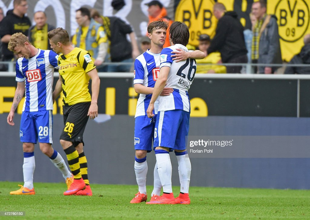 Valentin Stocker and Nico Schulz of Hertha BSC hug during the game between Borussia Dortmund and Hertha BSC on May 9, 2015 in Dortmund, Germany.