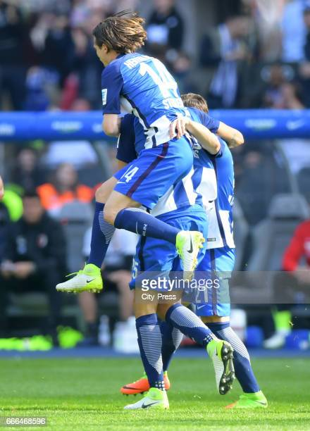 Valentin Stocker John Anthony Brooks and Marvin Plattenhardt of Hertha BSC celebrate after scoring the 10 during the game between Hertha BSC and FC...