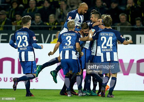 Valentin Stocker of Berlin celebrate with his team mates after he scores the opening goal during the Bundesliga match between Borussia Dortmund and...