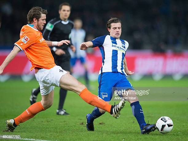 Valentin Stocker of Berlin is challenged by Peter Niemeyer of Darmstadt during the Bundesliga match between Hertha BSC and SV Darmstadt 98 at...