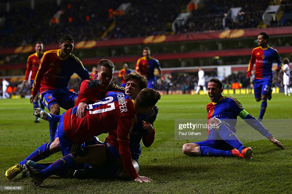 Valentin Stocker of FC Basel is mobbed by team mates after scoring their first goal during the UEFA Europa League quarter-final first leg between Tottenham Hotspur FC and FC Basel 1893 at White Hart Lane on April 4, 2013 in London, England.
