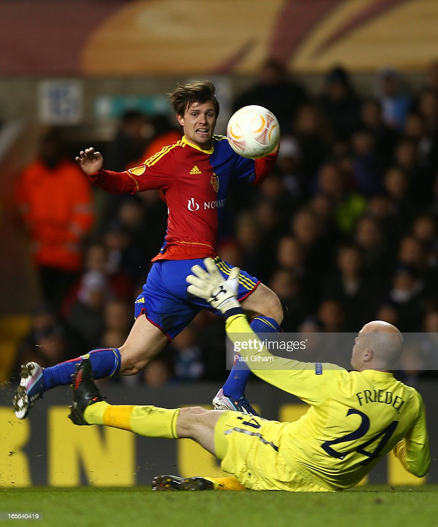 <a gi-track='captionPersonalityLinkClicked' href=/galleries/search?phrase=Valentin+Stocker&family=editorial&specificpeople=5522265 ng-click='$event.stopPropagation()'>Valentin Stocker</a> of FC Basel puts an effort at goal over <a gi-track='captionPersonalityLinkClicked' href=/galleries/search?phrase=Brad+Friedel&family=editorial&specificpeople=210857 ng-click='$event.stopPropagation()'>Brad Friedel</a> of Tottenham Hotspur during the UEFA Europa League quarter-final first leg between Tottenham Hotspur FC and FC Basel 1893 at White Hart Lane on April 4, 2013 in London, England.