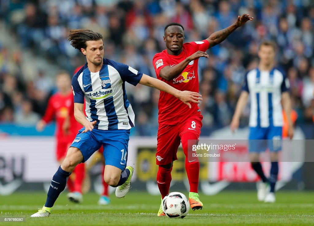 Valentin Stocker of Hertha BSC is challenged by Naby Keita of RB Leipzig during the Bundesliga match between Hertha BSC and RB Leipzig at Olympiastadion on May 6, 2017 in Berlin, Germany.