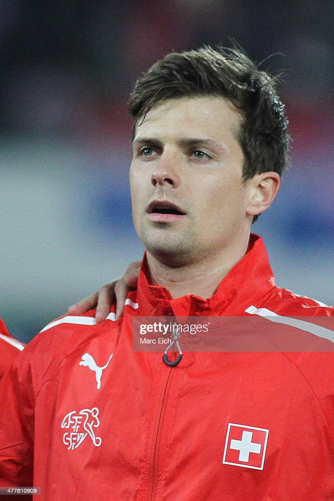 <a gi-track='captionPersonalityLinkClicked' href=/galleries/search?phrase=Valentin+Stocker&family=editorial&specificpeople=5522265 ng-click='$event.stopPropagation()'>Valentin Stocker</a> of Switzerland stands for the national anthem prior the international friendly match between Switzerland and Croatia at the AFG Arena on March 5, 2014 in St Gallen, Switzerland.