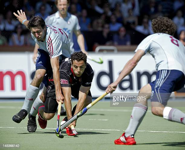Valentin Verga of Amsterdam vies with Jonas Swiatek of UHC Hamburg during the final of the Euro Hockey League in Amstelveen on May 27 AFP PHOTO/ ANP/...