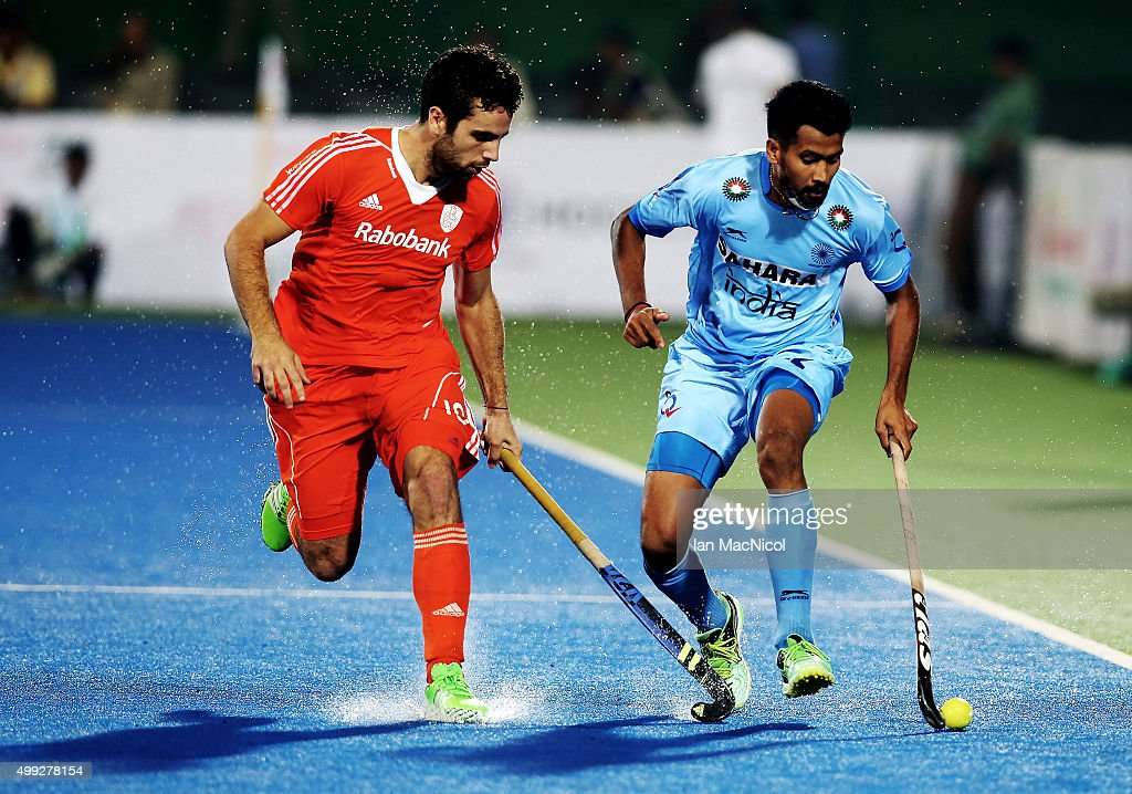 Valentin Verga of Netherlands vies with Devindar Walmiki of India during the match between Netherlands and India on day four of The Hero Hockey League World Final at the Sardar Vallabh Bhai Patel International Hockey Stadium on November 30, 2015 in Raipur, India.