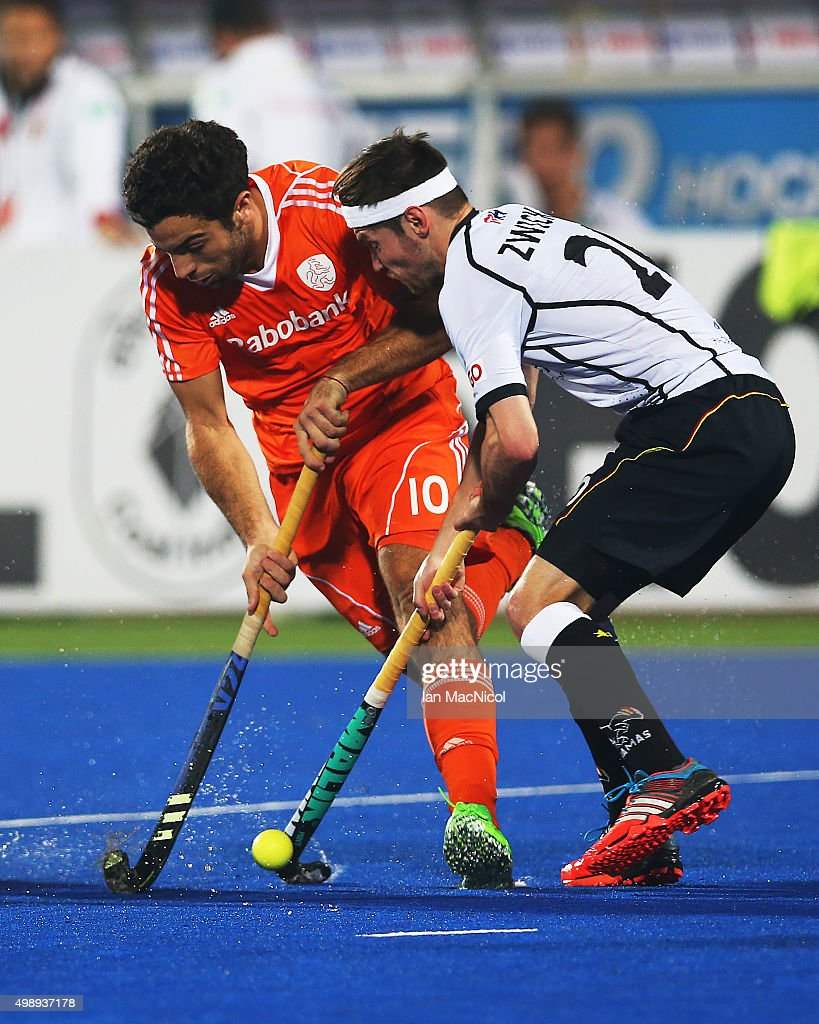 Valentin Verga of Netherlands vies with Martin Zwicker of Germany during the match between Netherlands and Germany on day one of The Hero Hockey League World Final at the Sardar Vallabh Bhai Patel International Hockey Stadium on November 27, 2015 in Raipur, India.