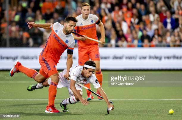 Valentin Verga of the Netherlands vies with Enrique Gonzalez of Spain during the European Hockey Championship match between Netherlands and Spain in...
