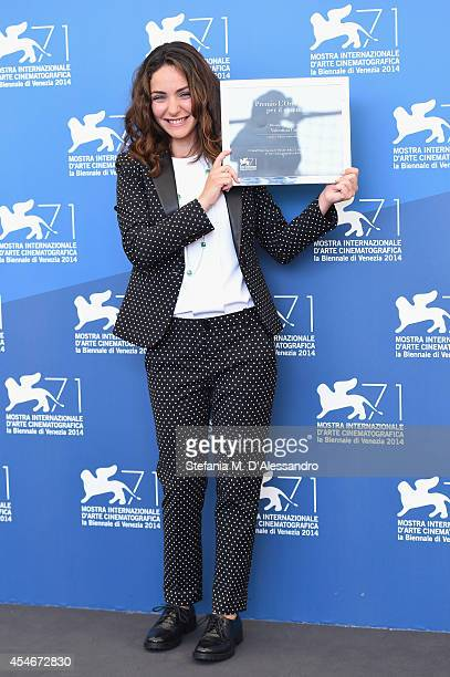 Valentina Corti poses with her L'Oreal Paris per il Cinema award during a photocall at the 71st Venice Film Festival on September 5 2014 in Venice...