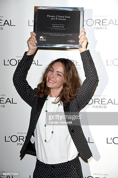 Valentina Corti poses with her L'Oreal Paris per il Cinema award at the 'L'Oreal Paris award for the Cinema' photocall during the 71st Venice Film...