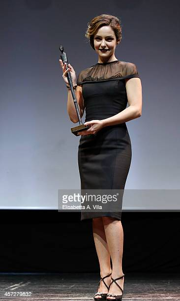 Valentina Corti poses with the award during the Premio Afrodite 2014 at Capitol Club on October 15 2014 in Rome Italy