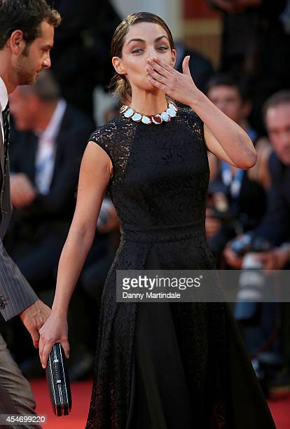 Valentina Corti waves to the crowd at the 'Good Kill' Premiere during the 71st Venice Film Festival at Sala Grande on September 5 2014 in Venice Italy