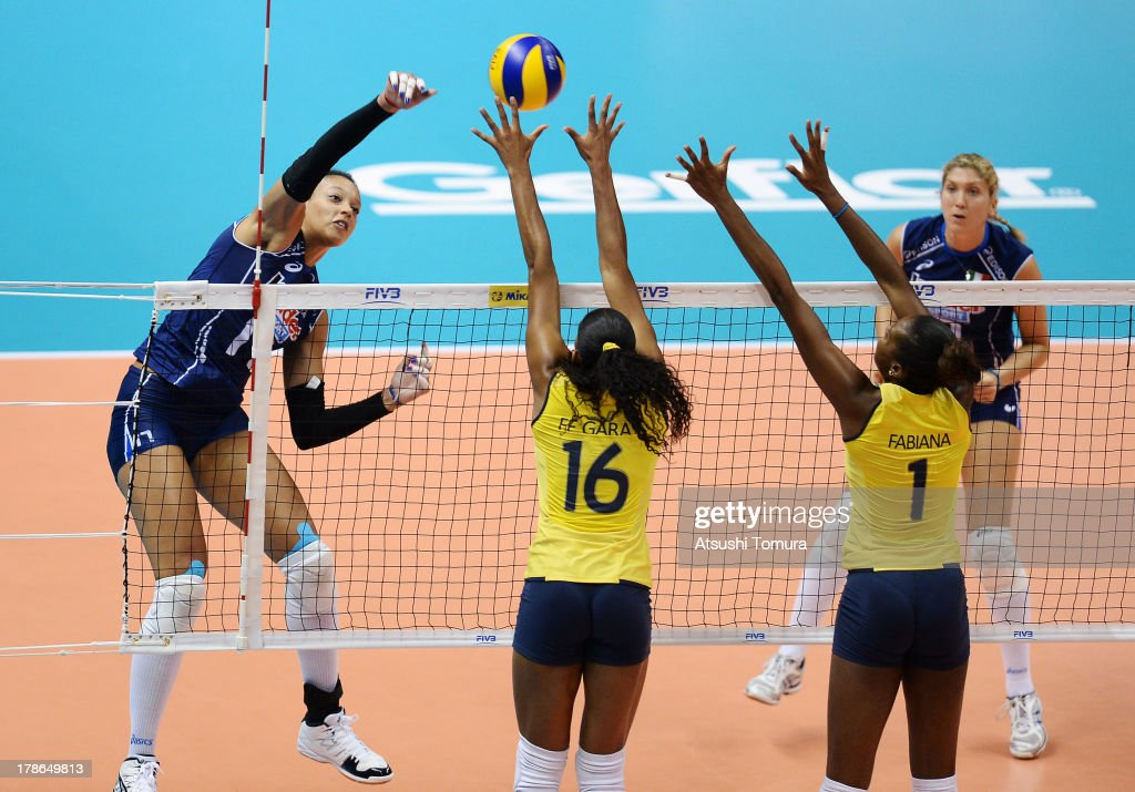Valentina Diouf of Italy spikes the ball during day three of the FIVB World Grand Prix Sapporo 2013 match between Brazil and Italy at Hokkaido Prefectural Sports Center on August 30, 2013 in Sapporo, Hokkaido, Japan.