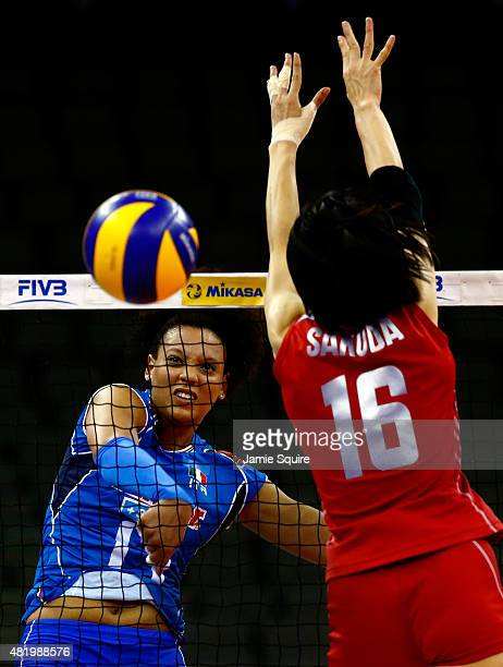 Valentina Diouf of Italy spikes the ball past Saori Sakoda of Japan during the final round match on day 4 of the FIVB Volleyball World Grand Prix on...